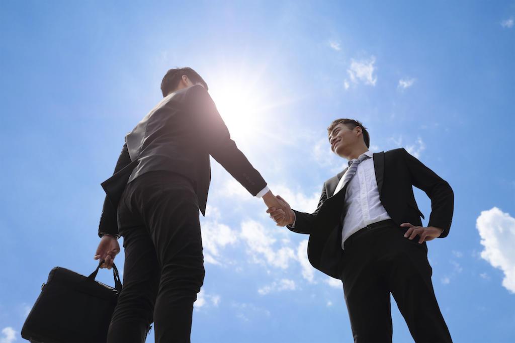 business men handshaking
